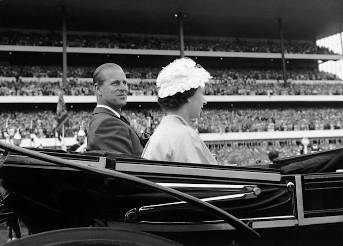 Her Majesty Queen Elizabeth II and her husband Prince Philip, Duke of Edinburgh, arrive in a carriage to attend the opening ceremonies of the 100th running of the Queen's Plate