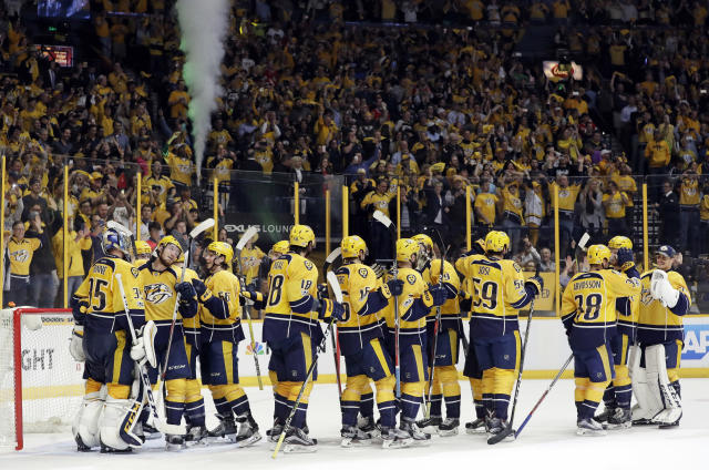 Nashville Predators players celebrate after defeating the Chicago Blackhawks 4-1 in Game 4 to sweep the first-round NHL hockey playoff series Thursday, April 20, 2017, in Nashville, Tenn. (AP Photo/Mark Humphrey)