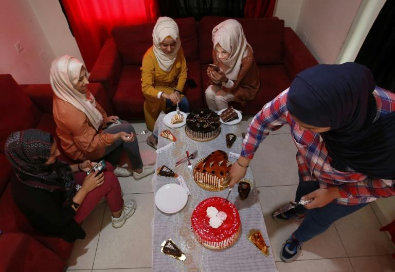 Palestinian women share a meal at the Queen Restaurant for women only near the city of Hebron in the occupied West Bank