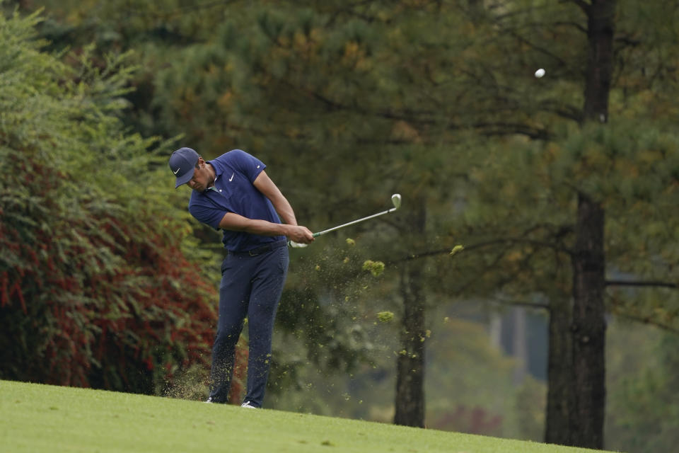 Tony Finau hits on the 15th fairway during a practice round for the Masters golf tournament Wednesday, Nov. 11, 2020, in Augusta, Ga. (AP Photo/Charlie Riedel)