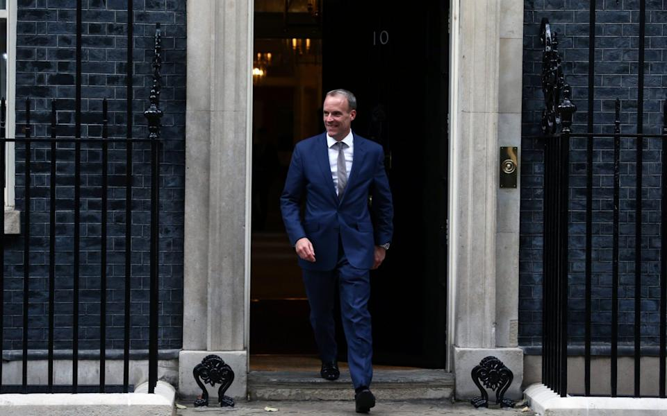 Brave face: Dominic Raab made a speedy exit from No 10 yesterday - Anadolu Agency