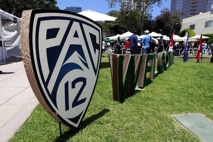Guests are welcomed to the Pac-12 football media day outside the commissary at Fox Studios in Los Angeles.
