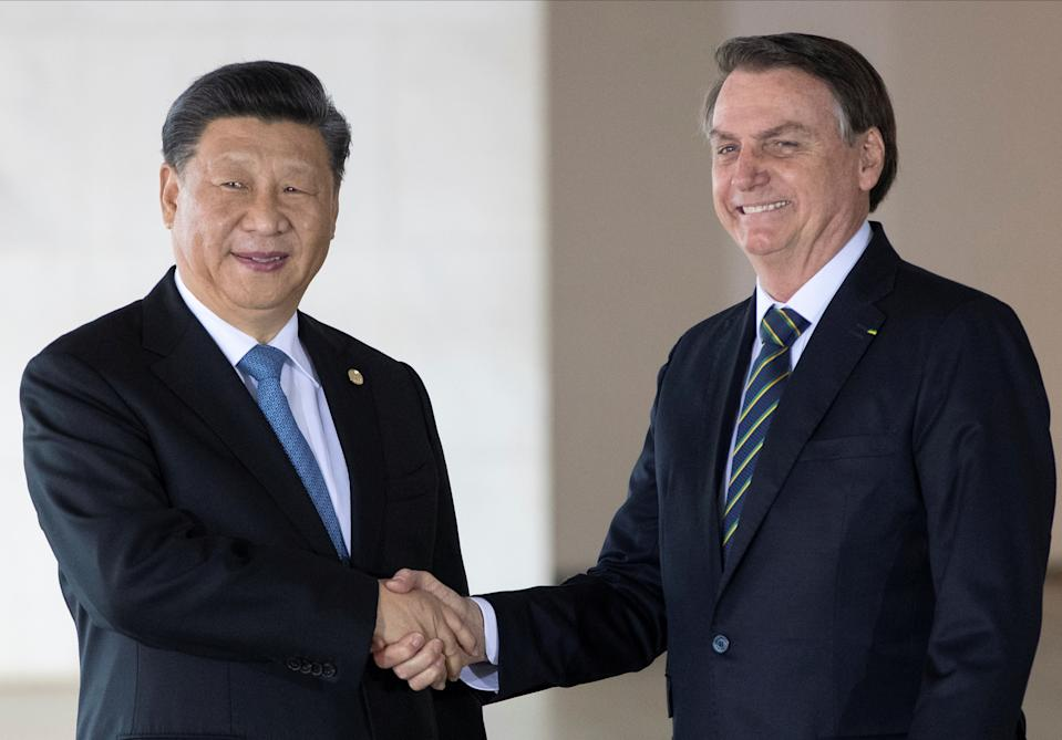 Brazil's President Jair Bolsonaro, right, and China's President Xi Jinping pose for photo prior to a meeting of leaders of the BRICS emerging economies at the Itamaraty palace in Brasilia, Brazil, Thursday, November 14, 2019. Pavel Golovkin/Pool via REUTERS