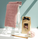 """<p><a class=""""link rapid-noclick-resp"""" href=""""https://www.stitchandstory.com/collections/knitting-kits/products/declan-scarf-knitting-kit"""" rel=""""nofollow noopener"""" target=""""_blank"""" data-ylk=""""slk:BUY NOW"""">BUY NOW</a> £48.00, Stitch and Story </p><p>A stunning cable knit blanket that will keep you cosy during the winter months or would make the perfect crafty present for someone you love. The blush pink is also super on trend.</p><p><strong>What's in the kit?</strong> 3 x100g S&S The Chunky Wool, a pair of 12mm bamboo knitting needles, scarf pattern, sewing needle and basic knitting instructions.</p><p><strong>Best for:</strong> those who don't mind a little challenge.</p>"""