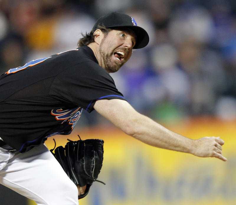 New York Mets pitcher R.A. Dickey (43) follows through on a pitch against the Atlanta Braves in the first inning of a baseball game at Citi Field in New York, Sunday, June 5, 2011. (AP Photo/Paul J. Bereswill)
