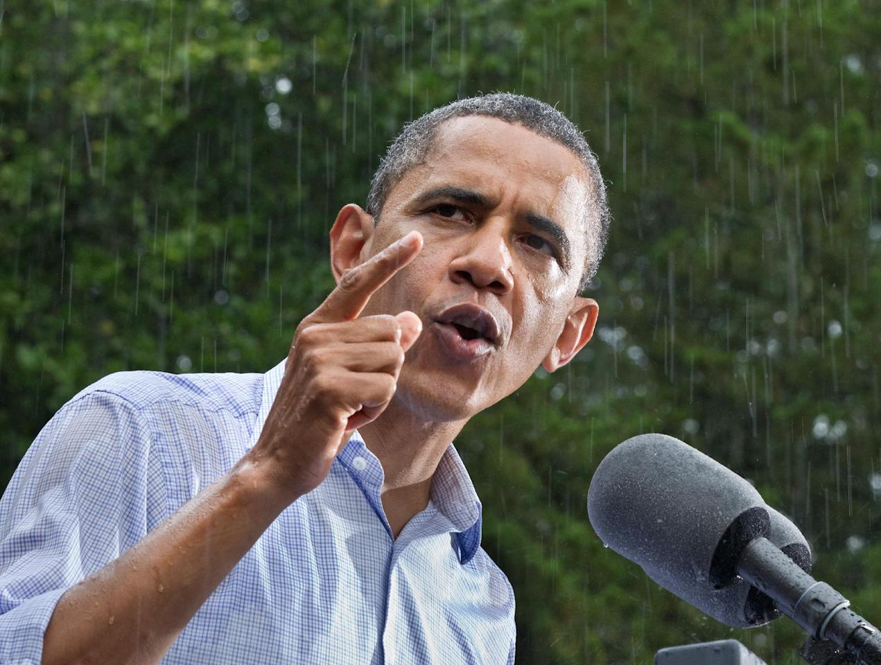President Barack Obama campaigns despite the pouring rain at the historic Walkerton Tavern & Gardens in Glen Allen, Va., near Richmond, Saturday, July 14, 2012. It is in the Congressional district represented by Republican House Majority Leader Eric Cantor, R-Va., a key county in a crucial swing state of the presidential election. (AP Photo/J. Scott Applewhite)