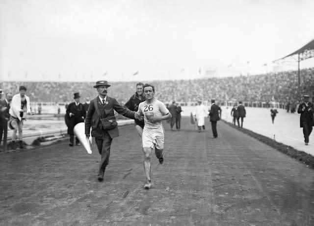 Johnny Hayes was credited with the first official record (PA)