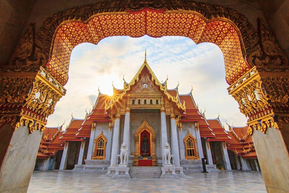 """<p>Every flamboyant high gable, ornate finial, and elaborate hall of Bangkok's most celebrated temple is built entirely of Italian carrara marble, earning it the nickname the """"Marble Temple."""" Prince Narisara Nuvadtivongs, half-brother of King Chulalongkorn the Great, began designing the temple in 1899 and, over the next 11 years, the grand structure, featuring more than 52 Buddha statues on pillars and stained glass windows with images of the Thai angels, came to life. </p>"""