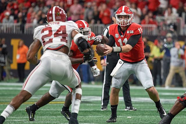 Georgia QB Jake Fromm (11) handles the football during the College Football Playoff title game against Alabama on Jan. 8, 2018. (Getty)
