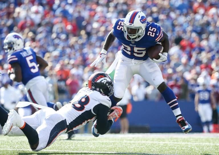 Von Miller of the Denver Broncos attempts to tackle LeSean McCoy of the Buffalo Bills during their NFL game at New Era Field in Orchard Park, New York, on September 24, 2017