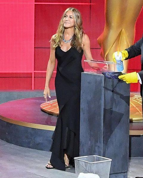 """<p>Aniston wore a black, bias-cut, silk dress by John Galliano for Christian Dior to present the <a href=""""https://www.elle.com/uk/fashion/g29184702/emmys-best-dressed/"""" rel=""""nofollow noopener"""" target=""""_blank"""" data-ylk=""""slk:virtual Emmys"""" class=""""link rapid-noclick-resp"""">virtual Emmys</a>.</p><p>This is the second vintage Dior piece she has worn recently, leaving us wondering if she has quite the vintage collection at home.</p><p><a href=""""https://www.instagram.com/p/CFYQLGhjo2j/"""" rel=""""nofollow noopener"""" target=""""_blank"""" data-ylk=""""slk:See the original post on Instagram"""" class=""""link rapid-noclick-resp"""">See the original post on Instagram</a></p>"""