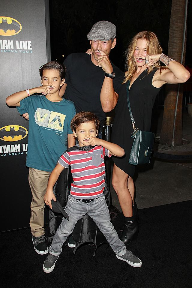 """<p class=""""MsoNormal""""><span>Despite recently spending 30 days <span>in rehab to """"cope with anxiety and stress,"""" singer </span>LeAnn Rimes looked to be in pretty good spirits when she hit the L.A. premiere of """"Batman Live"""" on Thursday with her husband, Eddie Cibrian and her stepsons, 9-year-old Mason and 5-year-old Jake. She was in such a good mood, in fact, she was willing to don a fake mustache … sort of. (9/27/2012)<br></span></p>"""