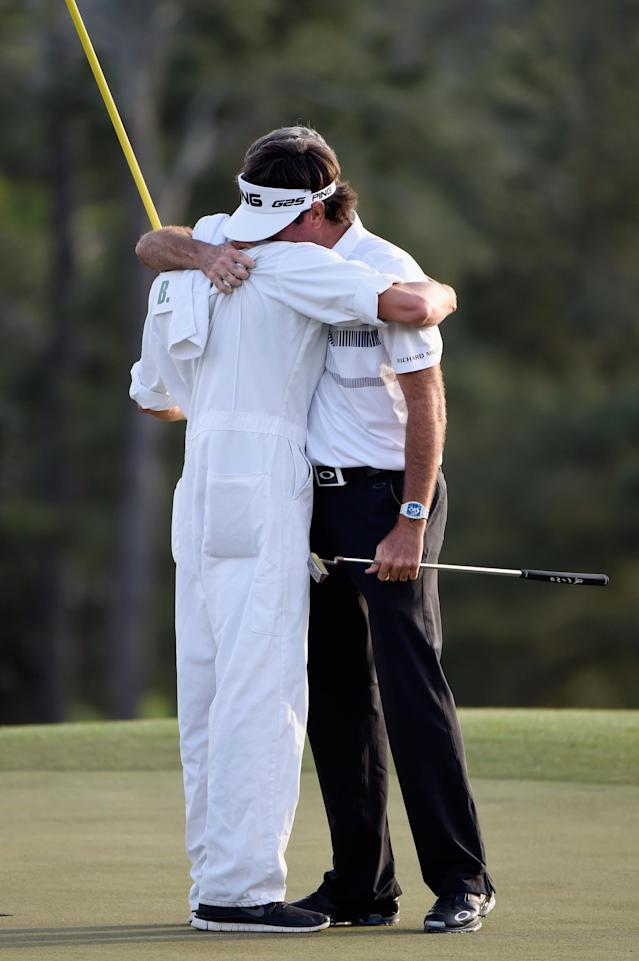 AUGUSTA, GA - APRIL 13: Bubba Watson of the United States celebrates with his caddie Ted Scott on the 18th green after winning the 2014 Masters Tournament by a three-stroke margin at Augusta National Golf Club on April 13, 2014 in Augusta, Georgia. (Photo by Harry How/Getty Images)