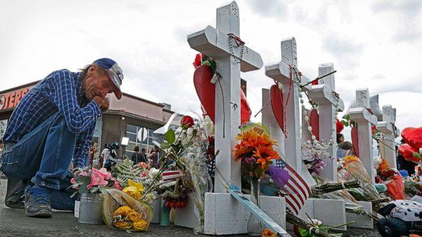 PHOTO: Antonio Basbo kneels in front of the cross for his partner Margie Reckard at the make shift memorial honoring the victims of the mass shooting in El Paso, Texas, Aug. 6 2019. (Larry W. Smith/EPA via Shutterstock)