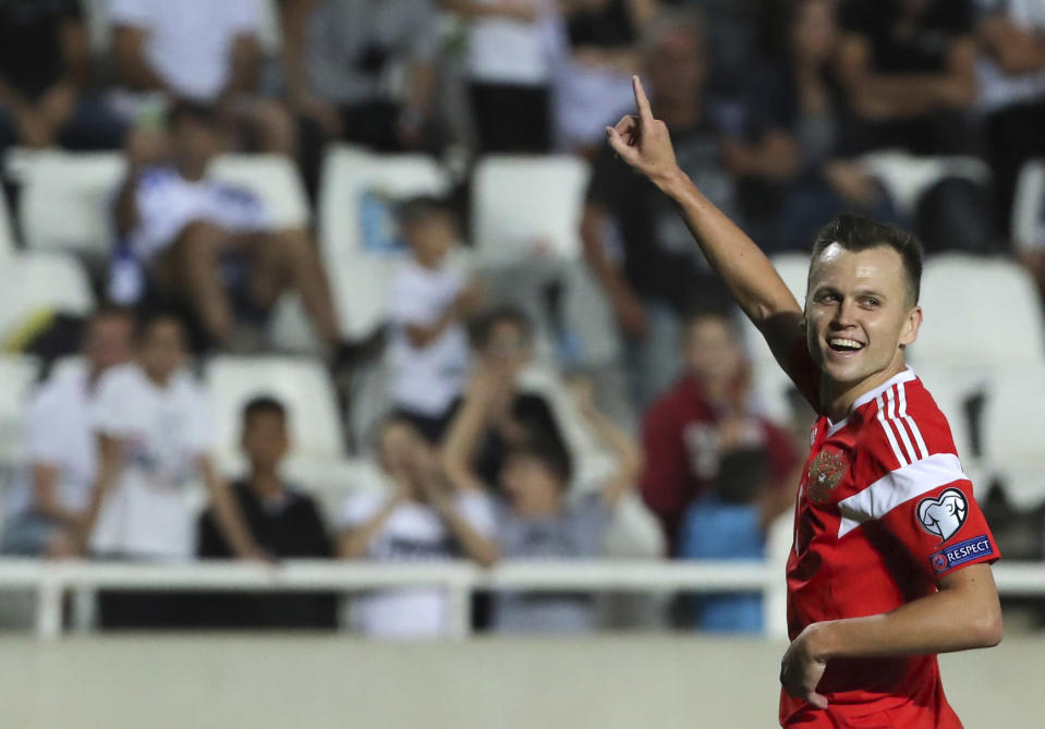 Russia's Denis Cheryshev celebrates after scoring his side's fifth goal during the Euro 2020 group I qualifying soccer match between Cyprus and Russia at GSP stadium in Nicosia, Cyprus, Sunday, Oct. 13, 2019. (AP Photo/Petros Karadjias)