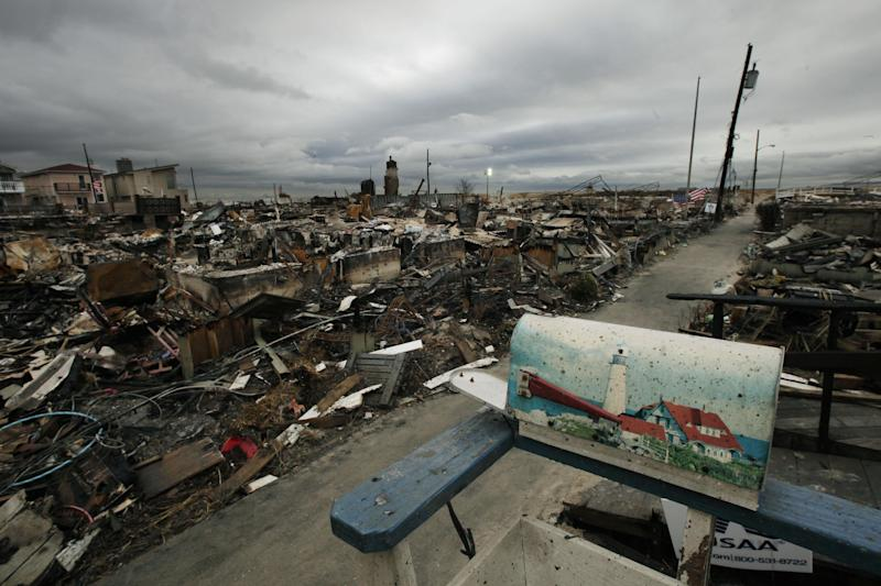 A mailbox with a lighthouse design sits on the porch of a burned out home in the Breezy Point section of New York's Queens borough on Tuesday, Nov. 13, 2012. More than 50 homes were lost in a fire that swept through the oceanside community during Superstorm Sandy. (AP Photo/Mark Lennihan)