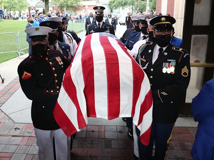 Members of the joint services military honour guard carry the casket of John Lewis into the Ebenezer Baptist Church on July 30, 2020 in Atlanta, Georgia: Getty Images