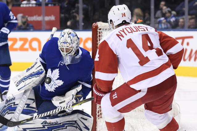 Toronto Maple Leafs goaltender Garret Sparks (40) makes a save on Detroit Red Wings right wing Gustav Nyquist (14) during the third period of an NHL hockey game Thursday, Dec 6, 2018, in Toronto. (Nathan Denette/The Canadian Press via AP)