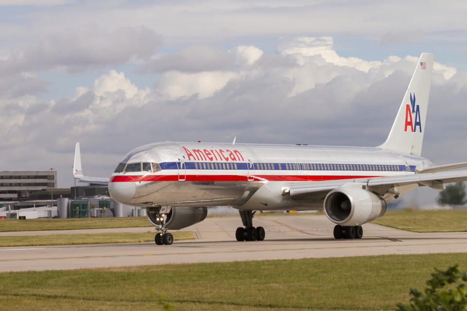 American Airlines Boeing 757 on runway waiting for take off at Manchester Airport