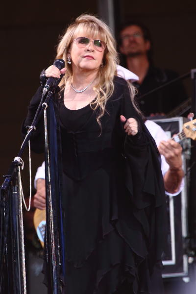 "FILE - This May 4, 2013 photo shows Stevie Nicks of Fleetwood Mac performing at The New Orleans Jazz & Heritage Festival in New Orleans, La. Lily Rabe's Stevie Nicks obsessed character on ""American Horror Story: Coven"" is in for a treat. The singer will guest star on an upcoming episode of the FX series. Creator Ryan Murphy revealed the guest spot news Tuesday, Nov. 12, over his official Twitter account. (Photo by John Davisson/Invision/AP, File)"
