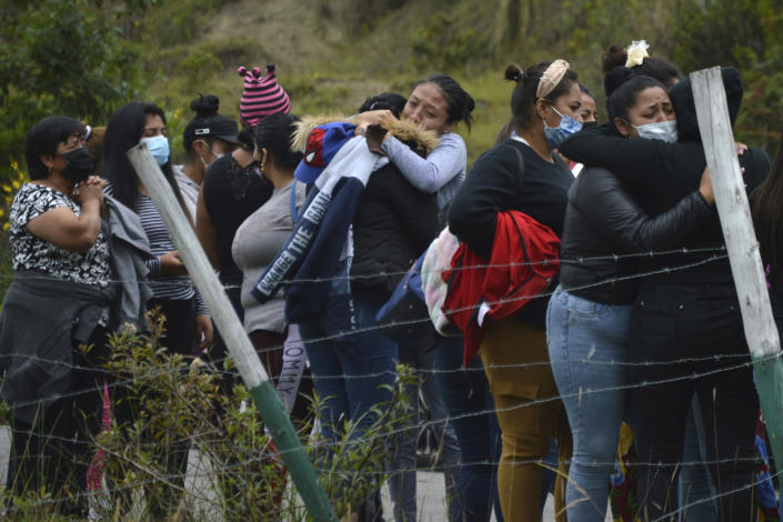 Prisoners' relatives gather outside Turi jail where an inmate riot broke out in Cuenca, Ecuador, Tuesday, Feb. 23, 2021. Deadly riots broke out in prisons in three cities across the country due to fights between rival gangs, according to police. (Boris Romoleroux/API via AP)