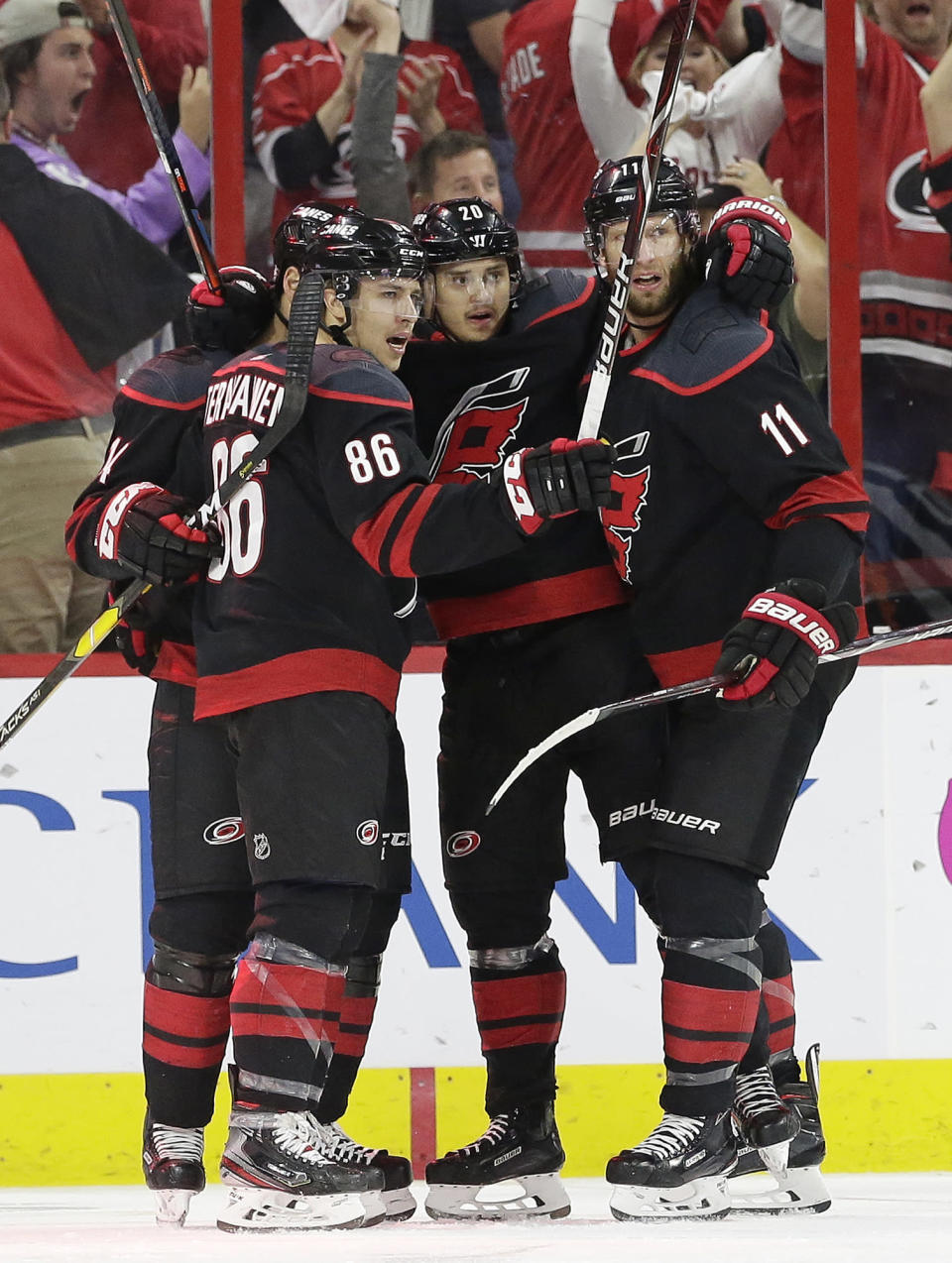Carolina Hurricanes' Teuvo Teravainen (86), of Finland, Sebastian Aho (20), also of Finland, and Jordan Staal (11) celebrate Aho's goal against the New York Islanders during the first period of Game 4 of an NHL hockey second-round playoff series in Raleigh, N.C., Friday, May 3, 2019. (AP Photo/Gerry Broome)