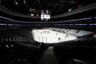 The Anaheim Ducks play the St. Louis Blues in an empty arena due to COVID-19 restrictions during the second period of an NHL hockey game Saturday, Jan. 30, 2021, in Anaheim, Calif. (AP Photo/Jae C. Hong)