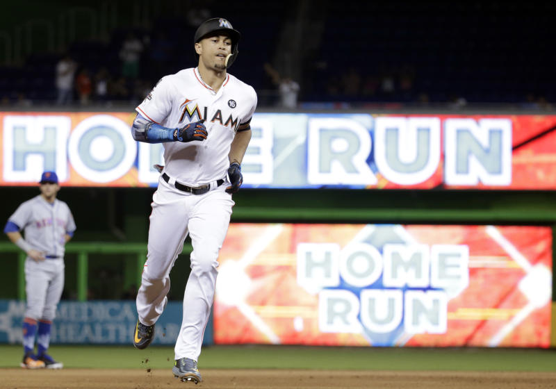 Giancarlo Stanton circling the bases after home run No. 55 on Monday night. (AP)