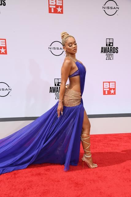 Saweetie wears Dolce & Gabbana on the red carpet at the 2021 BET Awards. - Credit: Michael Buckner for PMC