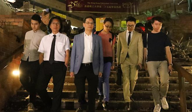 From left: Eastern district councillor Cheng Tat-hung, lawyer Daniel Wong Kwok-tung, lawmaker Ip Kin-yuen, social worker Chan Kim-kam, lawmakers Gary Fan Kwok-wai and Roy Kwong Chun-yu, arrived at the PolyU campus on Monday to search for protesters in hiding. Photo: Dickson Lee