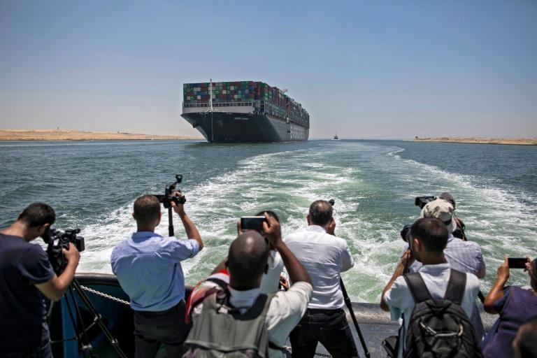Panama-flagged MV 'Ever Given' container ship sails along Egypt's Suez Canal near the canal's central city of Ismailia