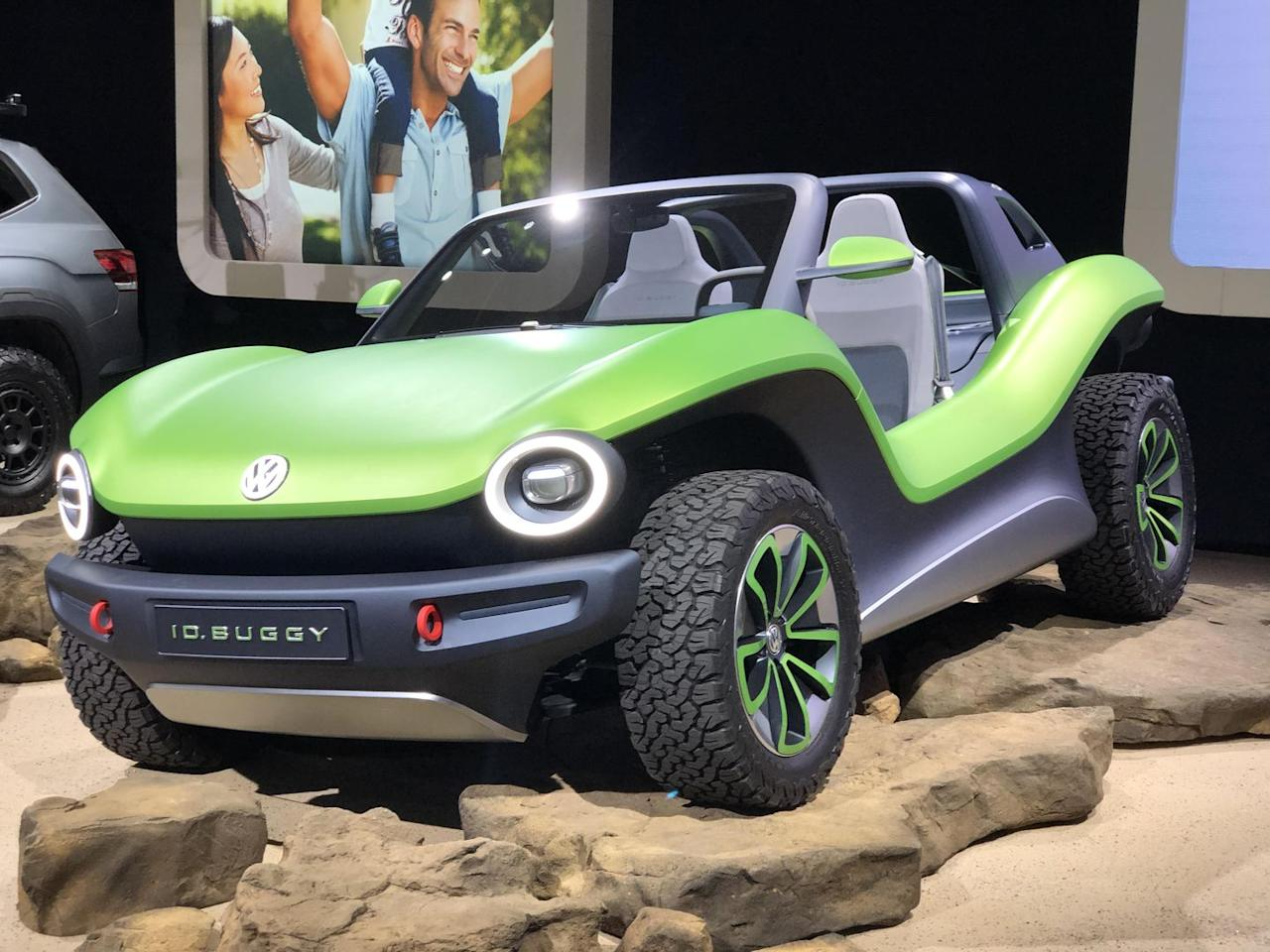 """<p>We said the Genesis Mint Concept """"might"""" be the best weird concept car of the show, and that's because it's got strong competition from the VW I.D. Buggy. Volkswagen made a chipper, open-top electric vehicle inspired by the dune buggies of the 1960s. The electric motor makes 201 hp and the top speed is limited to 99 mph. </p><p>If the I.D. Buggy's name and aesthetic feel familiar, it's because Volkwsagen's <a href=""""https://www.popularmechanics.com/cars/g2911/best-cars-north-american-auto-show/"""">concept show car of 2017</a> was the I.D. Buzz, a similarly shocking green ride that was an electric take on the classic <a href=""""https://www.popularmechanics.com/cars/trucks/a26207/volkswagen-microbus-vw-bus/"""">VW bus</a>. </p>"""
