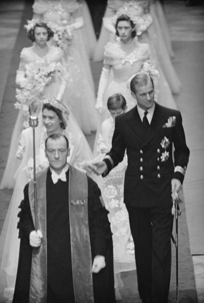 """<p>Princess Elizabeth (later Queen Elizabeth II) and Philip Mountbatten (later Prince Philip, Duke of Edinburgh) make their way down the aisle of Westminster Abbey on their <a href=""""https://www.goodhousekeeping.com/uk/news/a573550/queen-prince-philip-celebrate-70th-wedding-anniversary-with-a-new-portrait/"""" rel=""""nofollow noopener"""" target=""""_blank"""" data-ylk=""""slk:wedding day"""" class=""""link rapid-noclick-resp"""">wedding day</a> on 20 November 1947.</p>"""