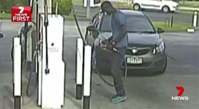 CCTV footage shows a man holding a fuel pump in one hand and a cigarette lighter in the other as he tries to set the bowser alight. Picture: 7 News