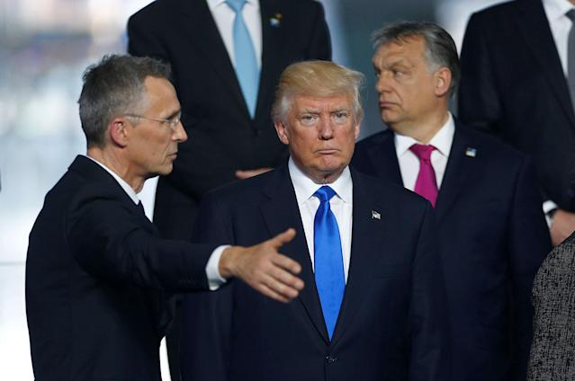 <p>NATO Secretary General Jens Stoltenberg (L) directs U.S President Donald Trump who takes his place as NATO member leaders gather before the start of their summit in Brussels, Belgium, May 25, 2017. (Hannibal Hanschke/Reuters) </p>