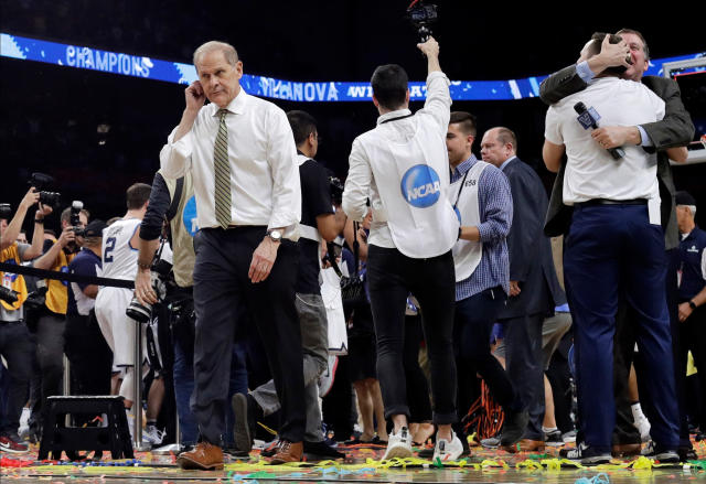 Michigan head coach John Beilein walks off the court after the championship game against Villanova in the Final Four NCAA college basketball tournament, Monday, April 2, 2018, in San Antonio. Villanova won 79-62.(AP Photo/David J. Phillip)
