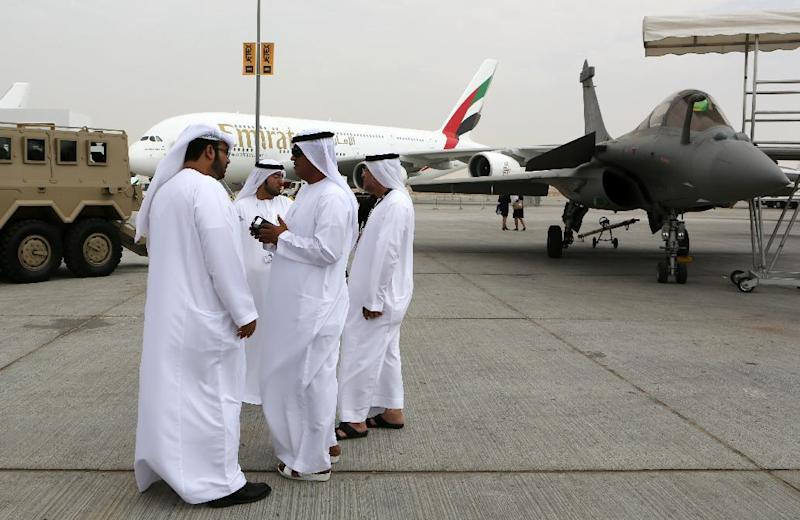 Emirati visitors talk in front of an Emirates Airbus A380 on display during the opening day of the Dubai Airshow in Dubai, United Arab Emirates, Sunday Nov. 17, 2013. The Dubai Airshow is seen as an increasingly important barometer on the state of the industry and the rising roles of the big-spending Gulf carriers Etihad, Qatar Airways and Emirates as they compete for routes and critical stopover traffic between Asia and Europe and the Americas. (AP Photo/Kamran Jebreili)