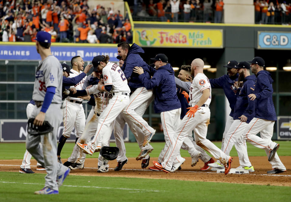 The Houston Astros celebrates after Alex Bregman game winning single during Game 5 of baseball's World Series against the Los Angeles Dodgers Monday, Oct. 30, 2017, in Houston. Astros won 13-12. (AP Photo/Matt Slocum)