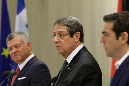 Cypriot President Nicos Anastasiades (C), Greek Prime Minister Alexis Tsipras (R) and Jordan's King Abdullah attend a news conference at the Presidential Palace in Nicosia, Cyprus January 16, 2018. REUTERS/Yiannis Kourtoglou