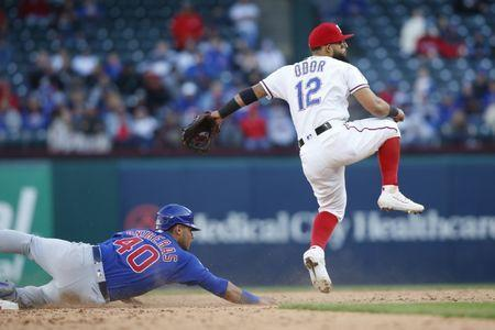 FILE PHOTO: Mar 31, 2019; Arlington, TX, USA; Texas Rangers second baseman Rougned Odor (12) turns a double play in the ninth inning against Chicago Cubs catcher Willson Contreras (40) at Globe Life Park in Arlington. Mandatory Credit: Tim Heitman-USA TODAY Sports