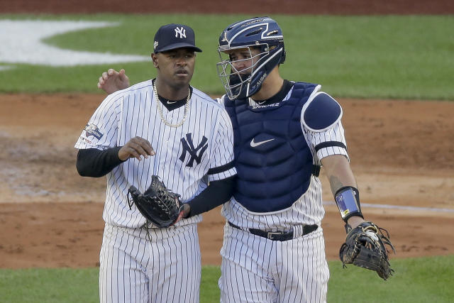 New York Yankees catcher Gary Sanchez talks on the mound with starting pitcher Luis Severino (40) during the fourth inning of Game 3 of baseball's American League Championship Series against the Houston Astros, Tuesday, Oct. 15, 2019, in New York. (AP Photo/Seth Wenig)