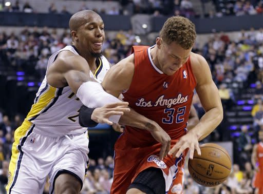 Indiana Pacers forward David West, left, knocks the ball away from Los Angeles Clippers forward Blake Griffin during the first half of an NBA basketball game in Indianapolis, Thursday, Feb. 28, 2013. (AP Photo/Michael Conroy)