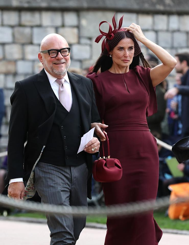 <p>Actress Demi Moore kept up the autumn theme in a plum-coloured dress by Malone Souliers and co-ordinating fascinator. <em>[Photo: Getty]</em> </p>