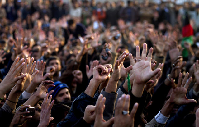Pakistani Shiite Muslims chant slogans during a rally to condemn Thursday's deadly bombings in Quetta, in Islamabad, Pakistan, Sunday, Jan. 13, 2013. Thousands of Pakistani Shiites protested in southwestern Pakistan for a third day blocking a main road with dozens of coffins of relative killed in explosions to demand better security from the government. (AP Photo/Anjum Naveed)