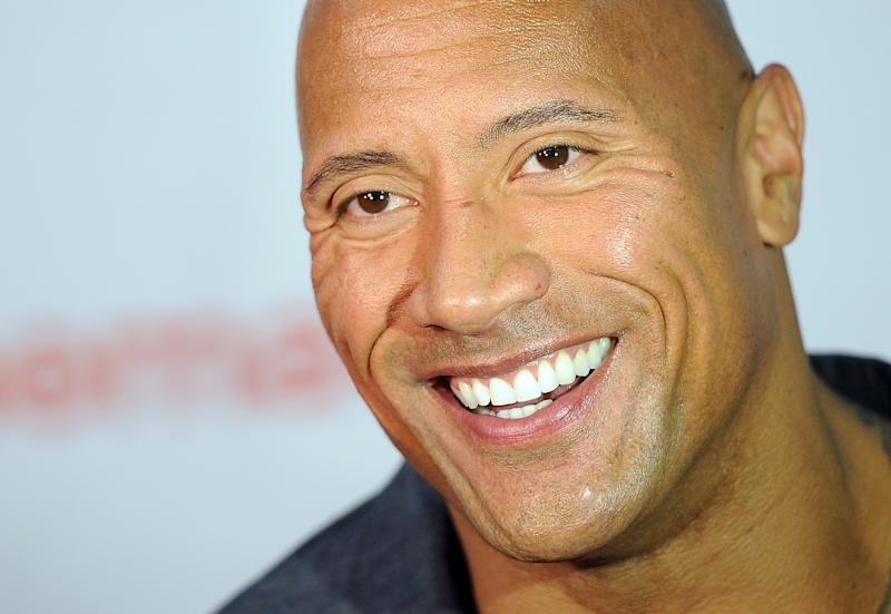 "Dwayne Johnson, star of the upcoming film ""Hercules,"" is interviewed before the Opening Night Presentation from Paramount Pictures at CinemaCon 2014 on Monday, March 24, 2014, in Las Vegas. (Photo by Chris Pizzello/Invision/AP)"