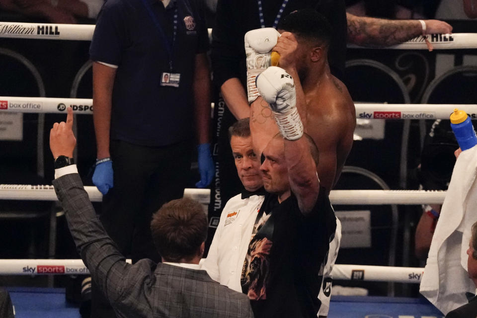 Oleksandr Usyk of Ukraine celebrates after his unanimous decision victory over Anthony Joshua of Britain in their WBA (Super), WBO and IBF boxing title bout at the Tottenham Hotspur Stadium in London, Saturday, Sept. 25, 2021. (AP Photo/Frank Augstein)