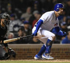 Chicago Cubs' Kyle Schwarber watches his RBI-single during the sixth inning of a baseball game against the Miami Marlins, Monday, May 6, 2019, in Chicago. (AP Photo/Paul Beaty)