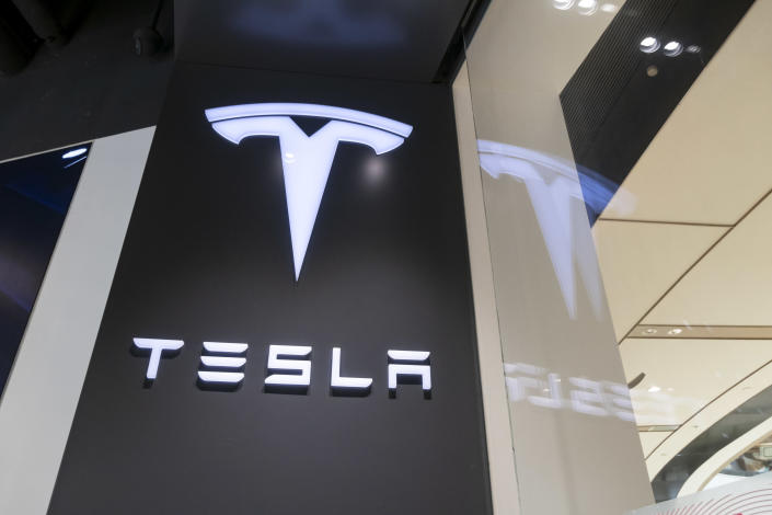 Tesla logo is seen at the Tesla experience store on August 11, 2020 in Shanghai, China. Photo: Wang Gang/VCG via Getty Images