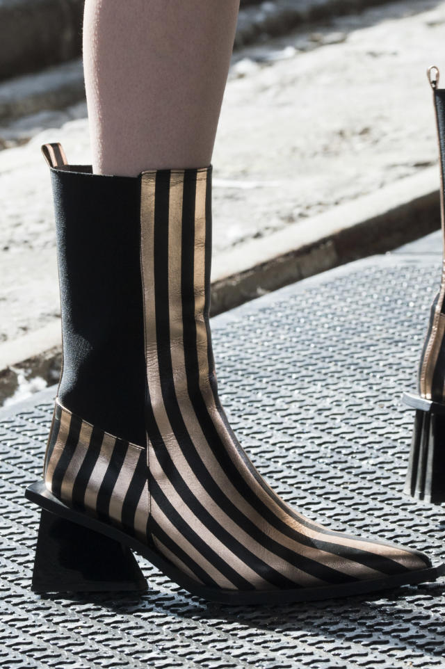 <p><i>Gold-and-black-striped chelsea boots from the SS18 Marques'Almeida collection. (Photo: ImaxTree) </i></p>