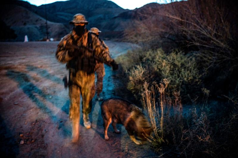 """""""Viper"""" and """"Stinger"""" — armed members of the Constitutional Patriots New Mexico Border Ops Team militia — patrol the border last month in Sunland Park, New Mexico. (Photo: PAUL RATJE via Getty Images)"""